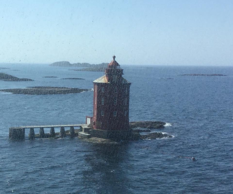 a lighthouse in the rain